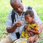 Medi Kanda Feeds Child